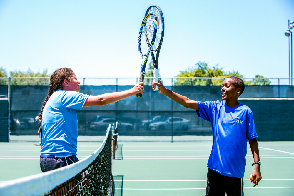 Tennis Students Racquets Up